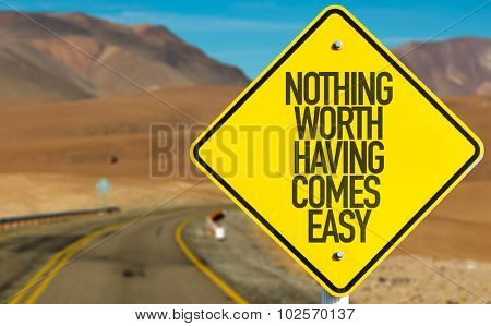 Nothing Worth Having Comes Easy sign on desert road