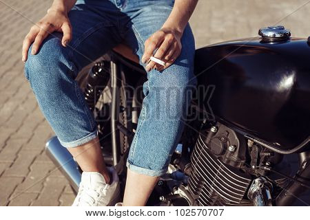 Young Woman On Motorcycle Smoking Sigarette