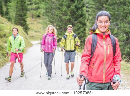 Group Of Friends Making Trekking Excursion In The Forest