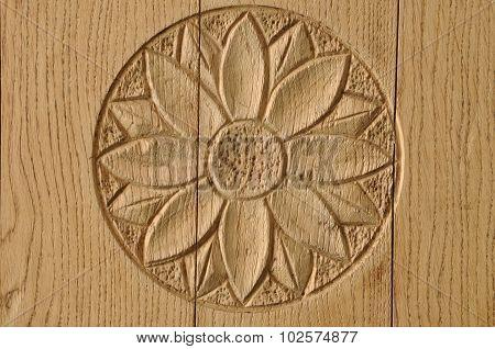 Floral wooden rosette on door