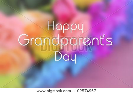 Happy Grandparents Day Blurred Background Flowers With Text.