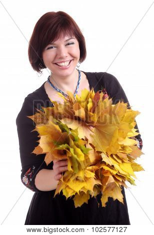 Brunette Girl Plays With Garland Of Yellow Leaves