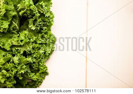 Cropped image of kale leaves on the table