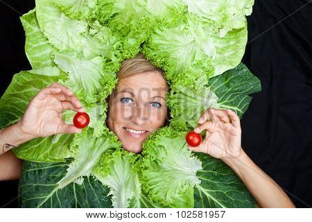 Cute Woman With Salad Leaves Arranged Around Her Head Holding Tomatoes