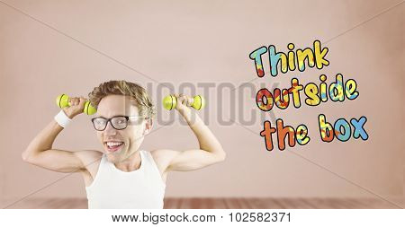 Nerd lifting weights against room with wooden floor