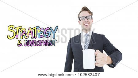 Happy geeky businessman holding coffee mug against strategy and development