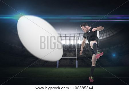 Rugby player kicking against rugby stadium
