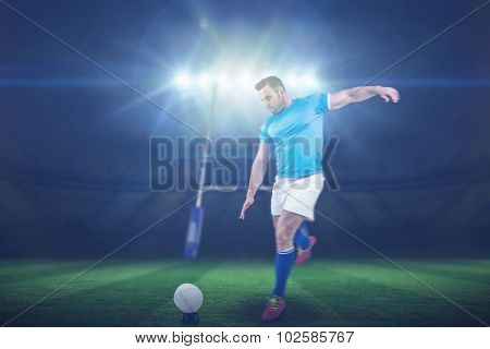 Rugby player ready to kick against rugby stadium