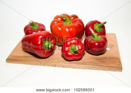 Many Ripe Red Peppers On Over White