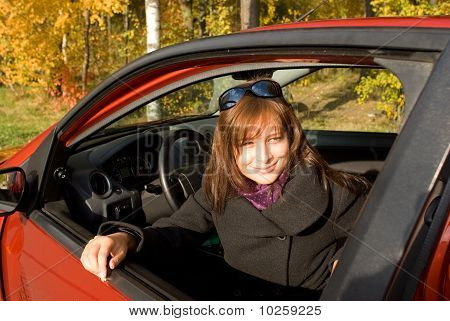 The Girl Sits In The Red Car