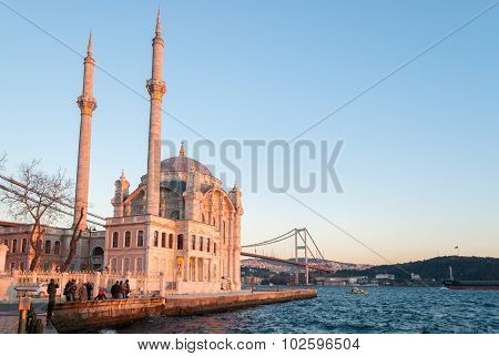 The Ortakoy Mosque In Istanbul With The Bridge Across The Bosphorus During The Sunset