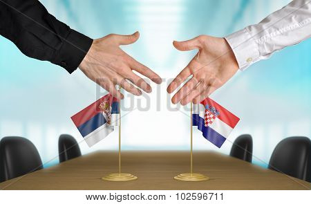 Serbia and Croatia diplomats agreeing on a deal