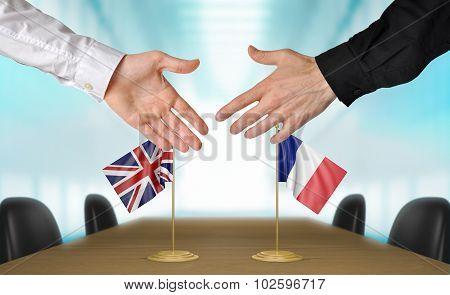 United Kingdom and France diplomats agreeing on a deal