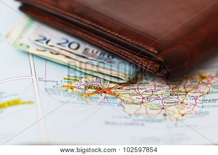 Euro Banknotes Inside Wallet On A Geographical Map Of Palma