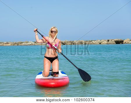 Woman On Stand Up Paddle