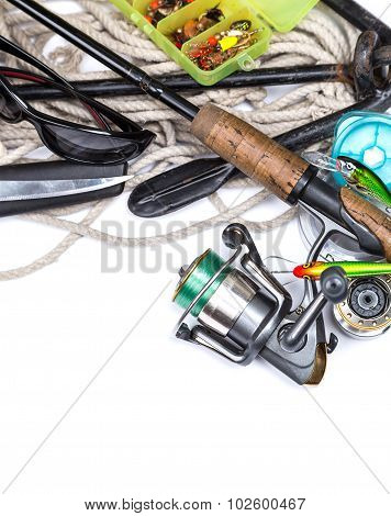 Fishing Tackles And Anchor With Cord On White