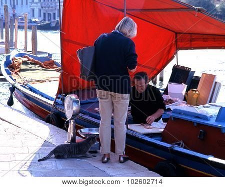 Fish seller on quayside, Venice.