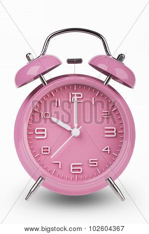 Pink Alarm Clock With Hands At 10 Am Or Pm isolated on white background
