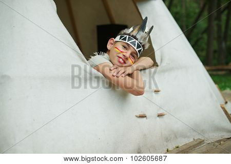 little funny boy with native american costume