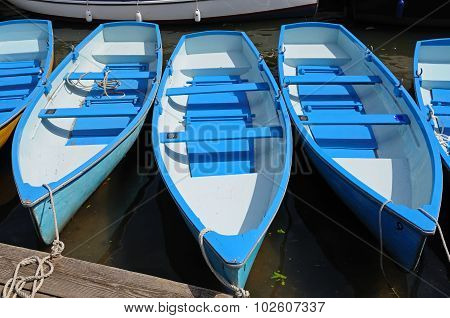 Blue and white rowing boats.