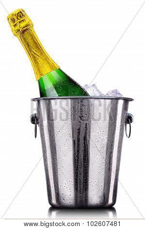 Bottle of champagne in ice bucket