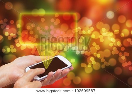 Hands With Smart Phone On The Abstract Christmas Background