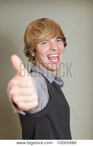 Happy Young Man Showing His Thumb Up