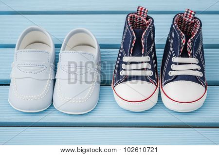 Pair Of Dark Blue, White Baby Sneakers And Blue Baby Shoes