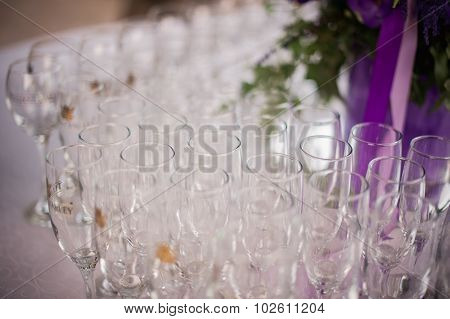 Many Empty Champagne  Glasses On Table