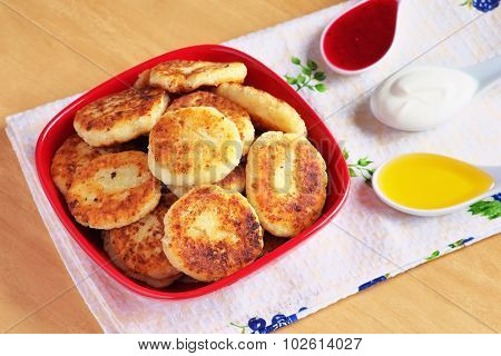 Syrniki. Cottage Cheese Pancakes. Fritters Of Cottage Cheese, Traditional Dish Ukrainian And Russian