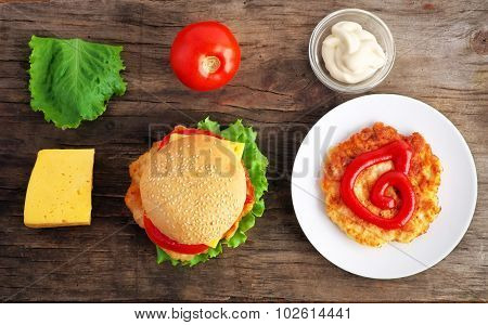 Hamburger With Fresh Vegetables, Cheese And Meat On A Old Wooden Table. Hamburger Ingredients
