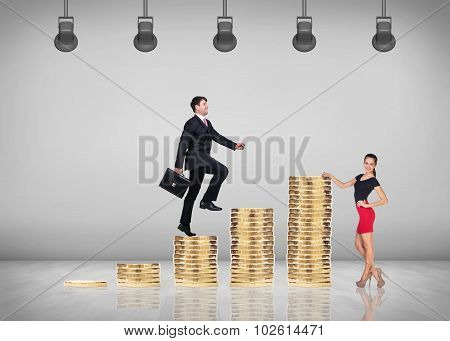 Man goes up by stairs from coins.