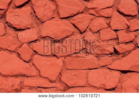 Background image of a stone wall of red