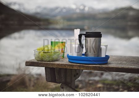 Camping Cuisine. Picnic Food On Wooden Table By The Lake.