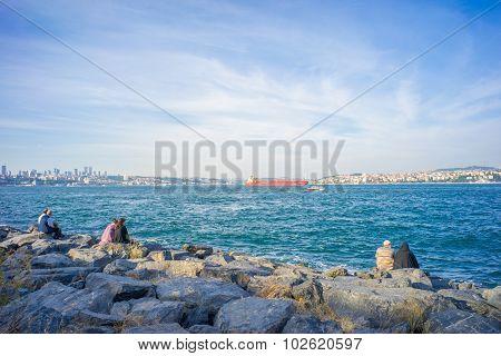 Three Couples On Rocks At Bosphorus Bank