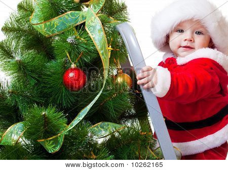 Baby In Santa Costume On A Step Ladde