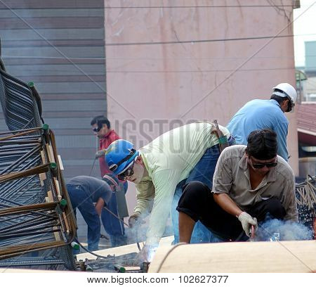 Construction Workers With Welding Equipment