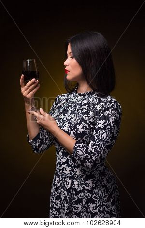 Asian woman with glass of red wine