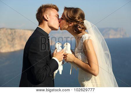 Wedding couple with pigeons