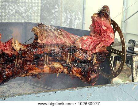 Bull Having Cooked On The Spit During