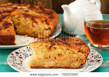 Homemade Yummy Apple Pie, Black Tea And White Teapot On Turquoise Table Closeup