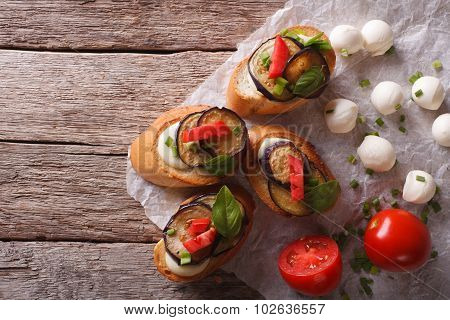 Sandwiches Crostini With Aubergine, Tomato And Cheese. Horizontal Top View
