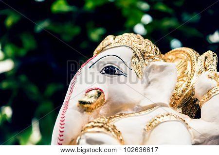 White  Ganesh Elephant Hindu God Statue Closeup Focused On Face