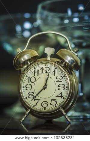 Retro Alarm Clock And Wine Glasses