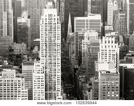 Black and white view of New York City with a view of Saint Patricks Church and the skyscrapers along Fifth Avenue