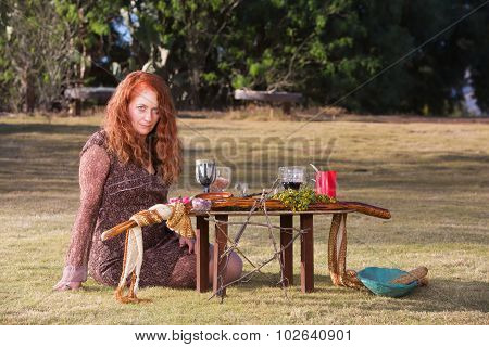 Pagan Priestess At Altar With Wine