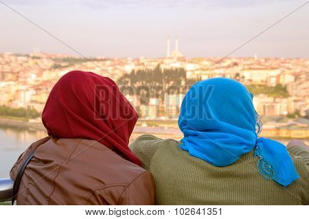 Two Muslim Women Overlooking The Panorama Of Istanbul