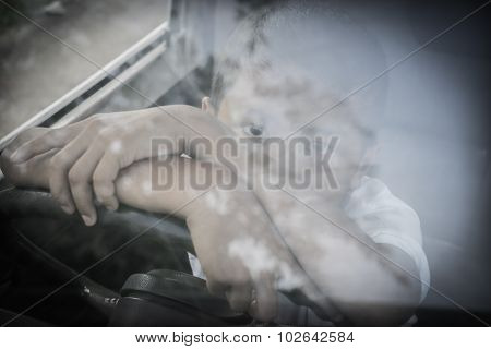 Young boy in a car