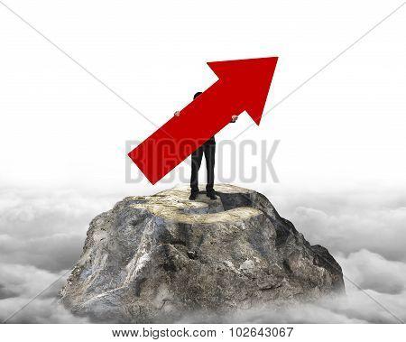 Man Holding Arrow Sign On Euro Mountain Peak
