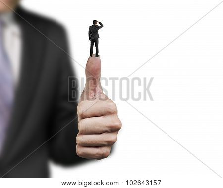 Businessman Standing On Top Of Another Big Thumb